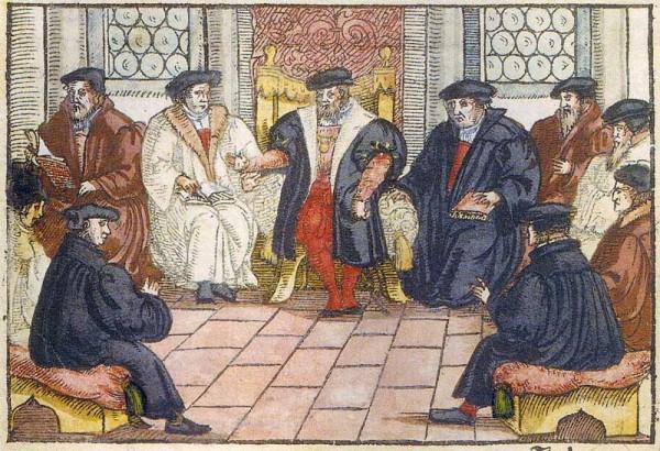Afbildning af det møde på slottet i Marburg, hvor Martin Luther og den schweiziske reformator Ulrich Zwingli i 1529 forsøgte at overkomme teologiske uenigheder - uden succes.